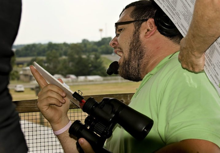 Michael Carter, 27, of Hamburg, New York,  announces the harness races from the crows nest at the Shenandoah County Fair on Wednesday.   Rich Cooley/Daily